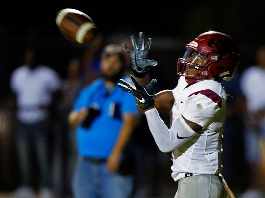 Maplewood's Makell Smith catches the ball for a touchdown