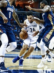 Memphis Grizzlies guard Dillon Brooks (middle) drives