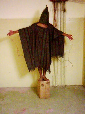 Interrogation techniques described in the Senate Intelligence Committee report are reminiscent of infamous images from the U.S.-controlled Abu Ghraib prison in 2003 in Iraq.