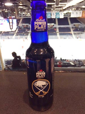 The Labatt Power Play Lager bottle features a thank you to Terry and Kim Pegula.