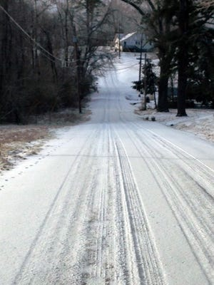 A side road covered with snow and ice in Burns on Wednesday.