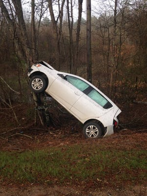 Louisiana State Police are investigating a crash that ended with the vehicle resting vertically against a tree.