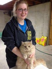 MAPS volunteer and Certified Veterinary Technician (CVT) Jurrisa Landowski holds Teddy the cat