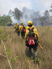 Florida Forest Service crews head toward a fire in the Mud Lake area of the Big Cypress National Preserve.