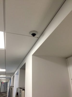 One of Dan Gilbert's security cameras in a hallway at the Free Press' offices.