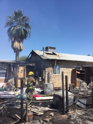 Fence fire causes extensive damage to the Phoenix home.