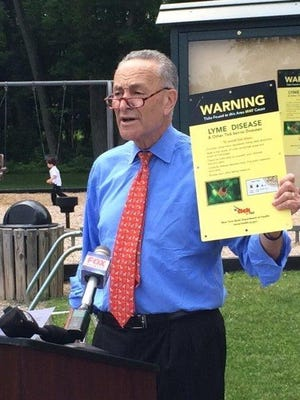 Sen. Chuck Schumer was in a Victor park Friday, June 12, 2015, to urge stepped-up federal efforts to combat Lyme and other tick-borne infections.