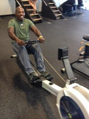Longtime Clarksville Athletic Club member Melvin Harris is thrilled with the new specialized fitness equipment at the expanded facility, including this rower.
