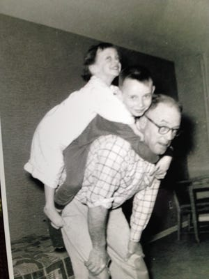 Howard Fleming with son David and daughter Carol Hoffman on  his back