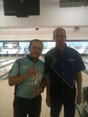Pensacola South Open champion Andres Gomez (left) shows off his top prize next to New Liberty Lanes owner Scott Oertel.