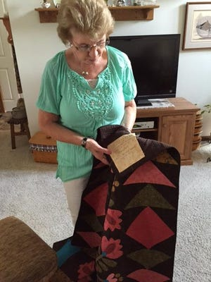 Marguerite Richards, 78, added a tag to explain where she learned the technique for her most recent quilt project.