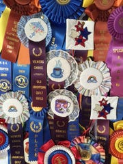 Marguerite Richards, 78, who will be recognized as the quilter of the year at the 2015 Mansfield Millennium Quilt Guild show, created a board of ribbons to display her quilting achievements.