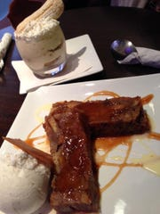 Creme's tiramisu in the background and warm banana bread pudding in the foreground.