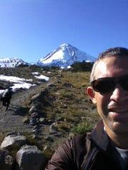 Scott Rapp shoots a selfie on a trail near Mount Hood
