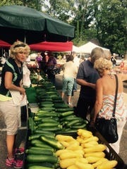 Michigan produce found a great home in the shade at the Huron River Hunting and Fishing Club during the Greater Farmington Founders Festival.