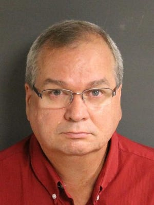 EMS worker Ronald A. Knighten has been charged with stealing money from the Springfield Township EMS squad.