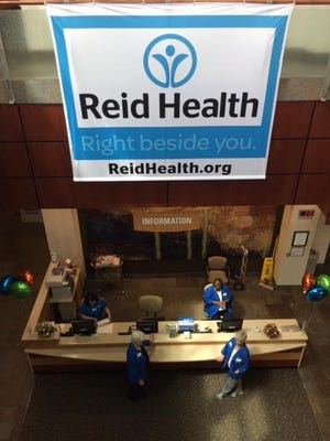 A new banner hangs over the information desk in the main lobby marking Reid Health's name transition from Reid Hospital & Health Care Services. The unveiling of the name and logo coincided with Reid's 110th anniversary.
