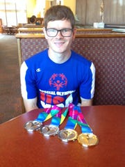 Proudly displaying one gold medal and three silver