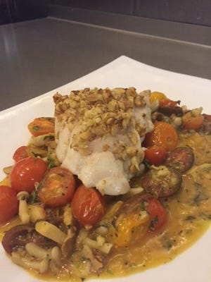 Renfroe walnut grouper with market-fresh heirloom tomato, mushroom ragout by Chef Matthew Brown at The Fish House.