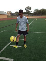 Dom Payne practices his foot work and juggling skills.