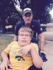 Brad Gentz of Osage plans to push his new friend Ryan Hemann in the Kickoff to Kinnick 5K on Sept. 13 in Iowa City