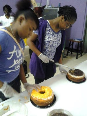 Beautiful Spirited Women participants work on making cakes at a BSW event.