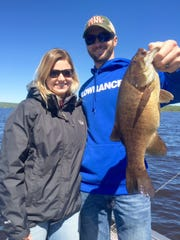 Jordan and Jackson Ryley with a hefty Chequamegon Bay smallmouth bass.