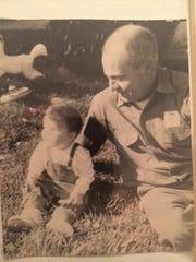 Orlin Denslow with his grandson, Jeff Cottrell, during a lunch break in 1964 at the Belle River Mills Compressor Station.