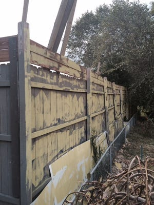 This ugly fence in a Fletcher neighborhood is legal under town zoning rules.