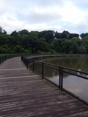 The wooden walkway over the Genesee at Turning Point Park.