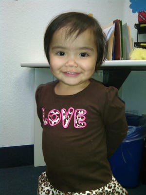 Adina, a 23-month-old Imperial County girl, poses for this undated photo. Adina died in privatized foster care in December 2014.
