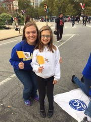 Maggie Fassano, a junior at the University of Delaware and little sister Brynn prepare to attend the Mass celebrated with Pope Francis in Philadelphia Sunday.