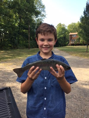 Aidan Apfel, 11, displays a large rainbow trout which he caught (a few weeks ago) in the Musconnetcong River in Asbury, Hunterdon County. With the fall  trout season beginning, he's looking for more.