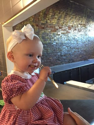 Copeland Pearl Benjamin, daughter of Bobby and Hannah Benjamin, enjoying her dad's gnocchi at Butchertown Grocery.