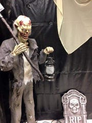A gravedigger stands guard at Paranoia Asylum, the El Paso County Sheriff's Office haunted house.
