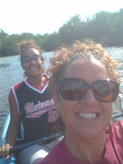 Kaiyana Spence, rear, and her mother, Marcy Spence