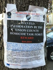 Poster offering reward for information in the Aug.