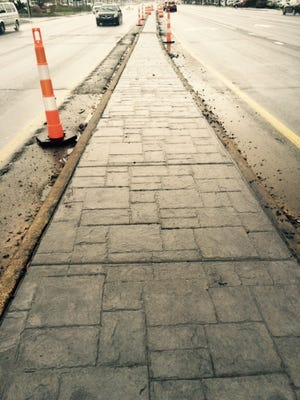 The DOT opted for a decorative concrete on Patton Avenue because it is a major entrance to the city.