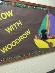 A bulletin board at Duson Elementary depicts Woodrow, one of two Scottish terriers who visit the school each week.