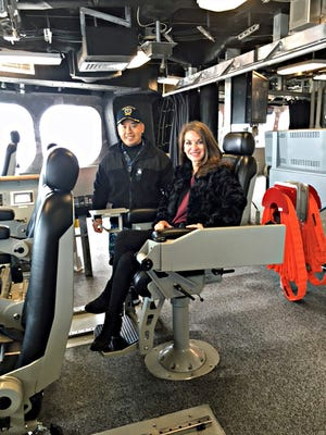 Commander Mike Davies and Donna Echols on the bridge of the USS Jackson.