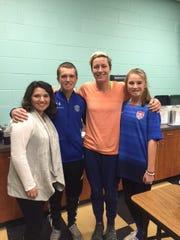 Noah McClard recently met U.S. national team member Abby Wambach. Pictured here: Sarah McClard, left , Noah McClard, Abby Wambach and Beth McClard.