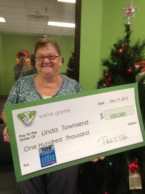 Linda Townsend, of Churchville, with her winnings from the Virginia Lottery.