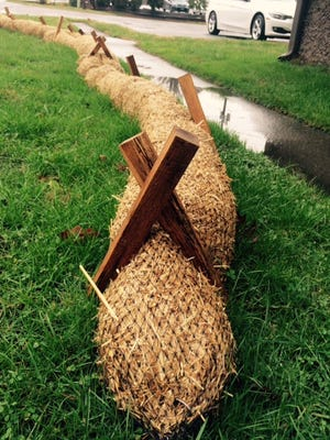 Duke Energy is employing straw wattles along Thompson Street to control erosion during pole replacements.