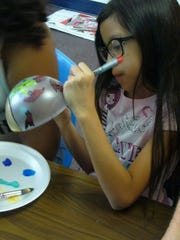 Children painted Arizona flora and fauna on the Christmas