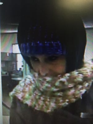 This is a surveillance photo of the suspect in the robbery of KeyBank on Ashland Road on Tuesday.