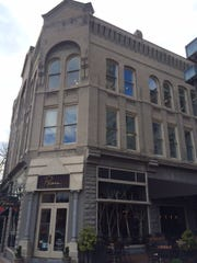 1 Biltmore Avenue, dating to 1887, is the oldest commercial building downtown — probably. It is home to Posana Restaurant on the first floor, offices above.