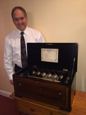 Gerry Wright, owner of Rita Ford's Music Boxes, is is considered one of the finest restorers of antique music boxes in the country.