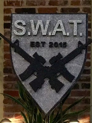 Krewe of S.W.A.T. logo.