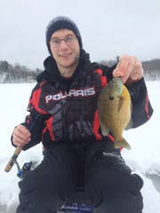 Tyler with a nice bluegill caught over the weekend