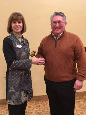 Past Door County Board of Realtors President Paul Dreutzer hands off the gavel to Cindy Koutnik as the 2016 president.